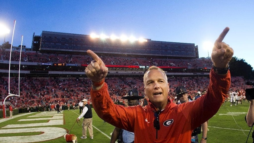 Georgia head coach Mark Richt gestures towards the band after defeating Vanderbilt  44-17 in an NCAA college football game Saturday, Oct. 4, 2014, in Athens, Ga. (AP Photo/John Bazemore)