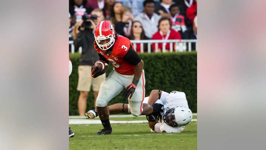 Georgia running back Todd Gurley (3) breaks away from Vanderbilt linebacker Darreon Herring (35) in the second  half of an NCAA college football game Saturday, Oct. 4, 2014, in Athens, Ga. Georgia won 44-17. (AP Photo/John Bazemore)