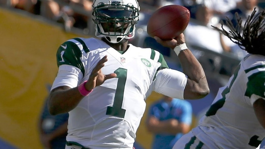 New York Jets quarterback Michael Vick throws against the San Diego Chargers during the second half of an NFL football game, Sunday, Oct. 5, 2014, in San Diego. (AP Photo/Lenny Ignelzi)