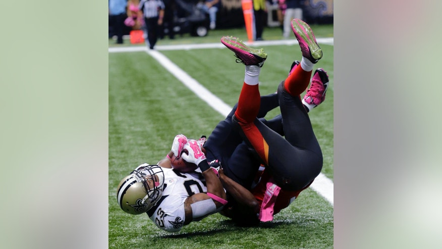 New Orleans Saints running back Pierre Thomas (23) breaks the goal line for a touchdown in the first half of an NFL football game against the Tampa Bay Buccaneers in New Orleans, Sunday, Oct. 5, 2014. (AP Photo/Bill Haber)