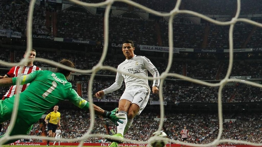 Real's Cristiano Ronaldo, right, scores his second goal during a Spanish La Liga soccer match between Real Madrid and Athletic Bilbao at the Santiago Bernabeu stadium in Madrid, Spain, Sunday, Oct. 5, 2014. (AP Photo/Andres Kudacki)