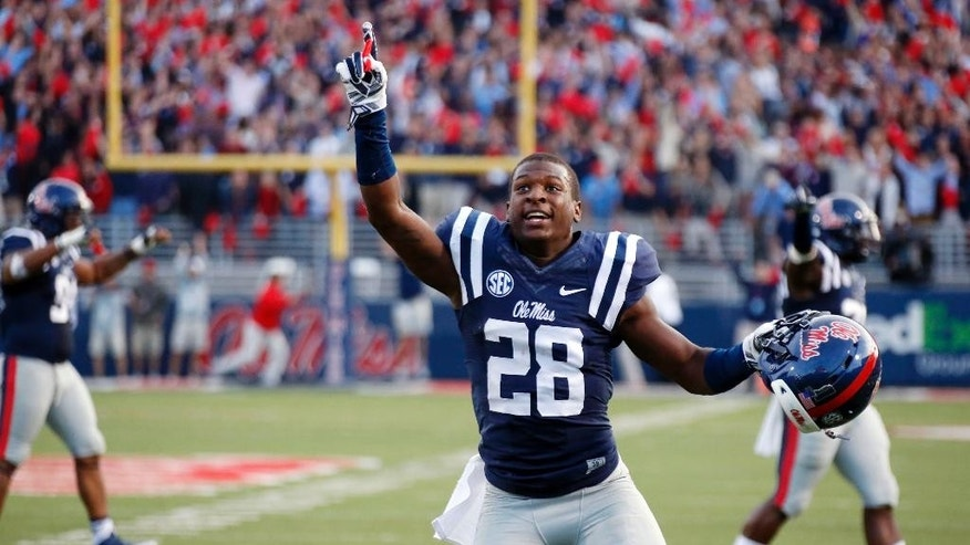 Mississippi defensive back Mike Hilton (28) celebrates his team's 23-17 win over No. 3 Alabama in an NCAA college football game in Oxford, Miss., Saturday, Oct. 4, 2014. (AP Photo/Rogelio V. Solis)