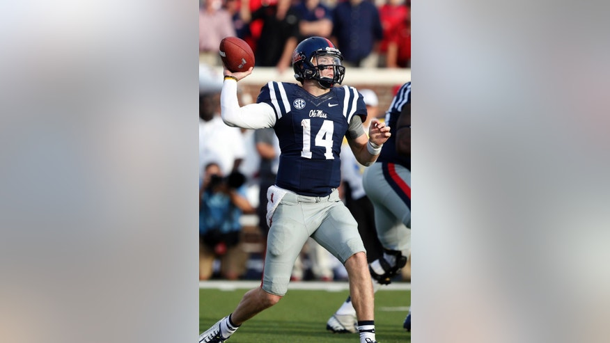 Mississippi quarterback Bo Wallace prepares to pass against Alabama during the second half of an NCAA college football game in Oxford, Miss., Saturday, Oct. 4, 2014. Mississippi won 23-17. (AP Photo/Rogelio V. Solis)