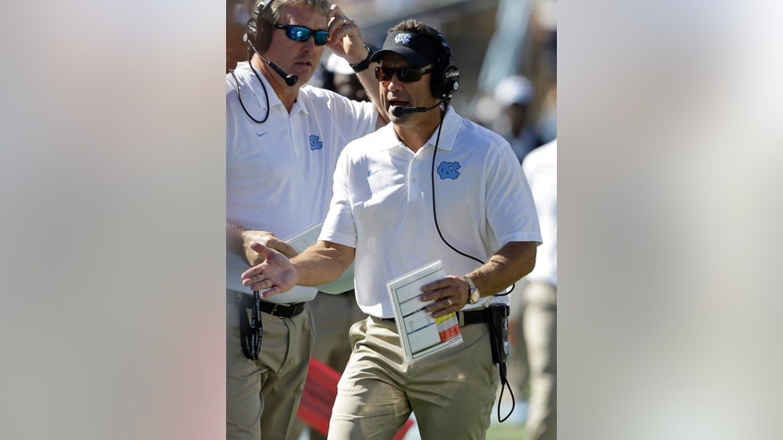 North Carolina coach Larry Fedora directs his team against  Virginia Tech during the second half of an NCAA college football game in Chapel Hill, N.C., Saturday, Oct. 4, 2014. Virginia Tech won 34-17. (AP Photo/Gerry Broome)