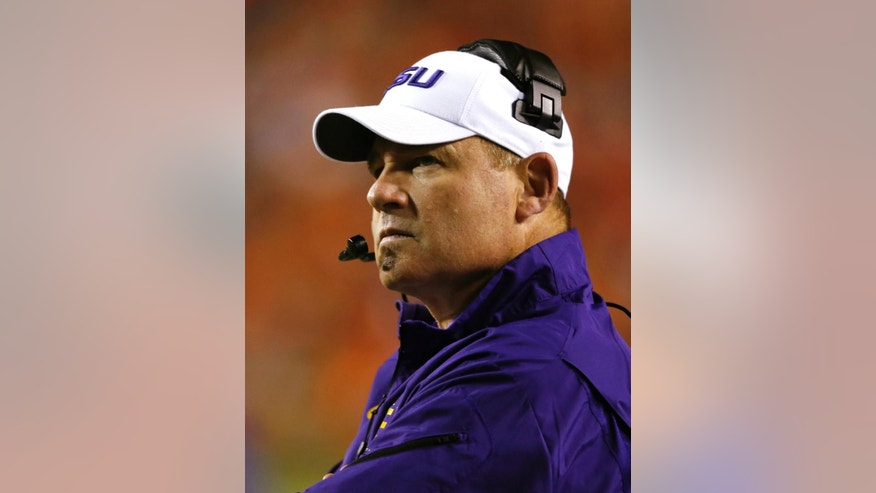 LSU coach Les Miles watches a replay during the second half of an NCAA college football game against Auburn on Saturday, Oct. 4, 2014, in Auburn, Ala. (AP Photo/Butch Dill)