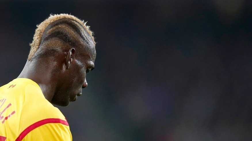 Liverpool's Mario Balotelli looks down during the Champions League Group B soccer match between FC Basel 1893 and Liverpool FC, at the St. Jakob-Park stadium in Basel, Switzerland, Wednesday, Oct. 1, 2014. (AP Photo/Keystone, Peter Klaunzer)