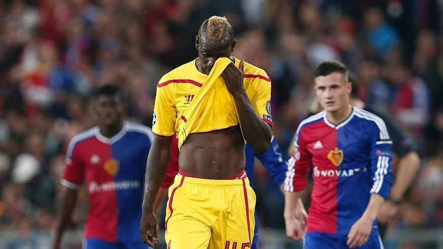 Liverpool's Mario Balotelli, center, leaves the pitch at halftime during the Champions League Group B soccer match between FC Basel 1893 and Liverpool FC, at the St. Jakob-Park stadium in Basel, Switzerland, Wednesday, Oct. 1, 2014. (AP Photo/Keystone, Peter Klaunzer)