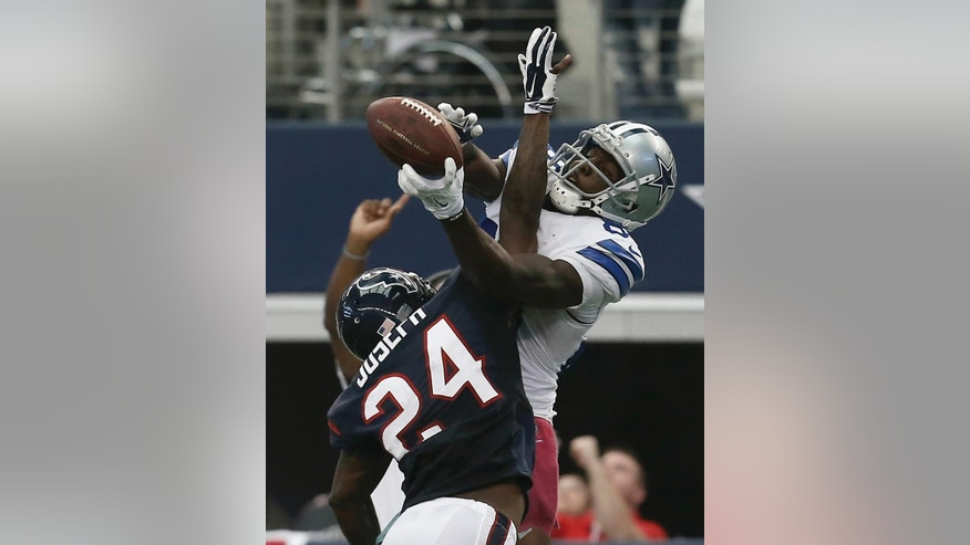 ***RETRANSMIT WITH ALTERNATIVE CROP*** Dallas Cowboys wide receiver Dez Bryant (88) grabs a pass over Houston Texans' Johnathan Joseph (24) in overtime of an NFL football game, Sunday, Oct. 5, 2014, in Arlington, Texas. The reception help set up a field goal by the Cowboys that gave them the 20-17 win. (AP Photo/Brandon Wade)