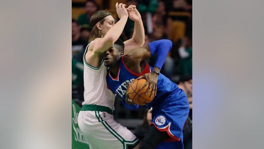 Philadelphia 76ers forward Nerlens Noel, right, slams into Boston Celtics center Kelly Olynyk on a drive to the basket during the first quarter of an NBA preseason basketball game in Boston, Monday, Oct. 6, 2014. (AP Photo/Charles Krupa)