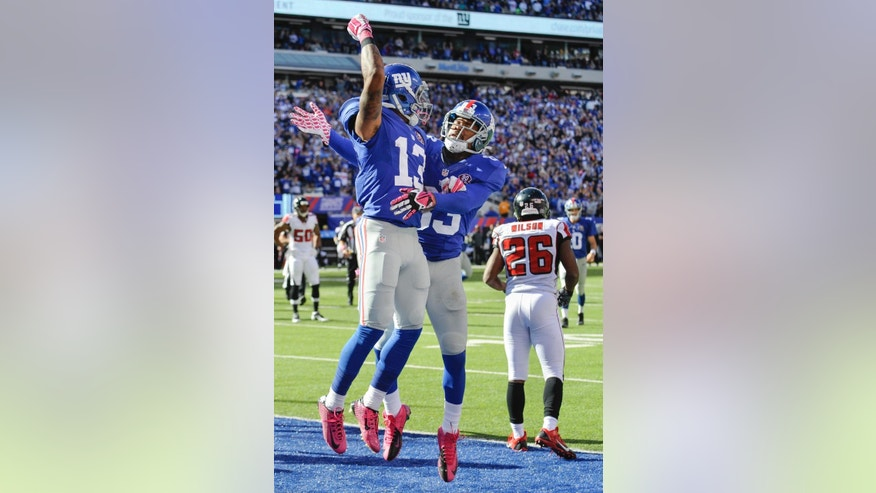 New York Giants wide receiver Odell Beckham, left, celebrates with wide receiver Preston Parker after scoring on a touchdown pass from quarterback Eli Manning during the second half of an NFL football game against the Atlanta Falcons, Sunday, Oct. 5, 2014, in East Rutherford, N.J. (AP Photo/Bill Kostroun)