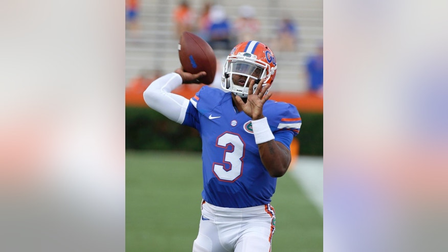 FILE - In this Sept. 13, 2014, file photo, Florida freshman quarterback Treon Harris (3) warms up prior to an NCAA college football game against Kentucky in Gainesville, Fla. Harris has been suspended while he is being investigated for sexual assault. The school says Harris is accused of sexually assaulting a female student early Sunday, Oct. 5, 2014, hours after Harris helped Florida rally to beat Tennessee 10-9 in Knoxville, in a residence hall on campus in Gainesville, Fla. (AP Photo/John Raoux, File)