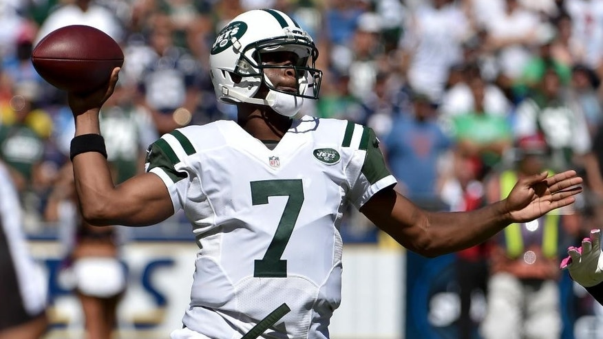 New York Jets quarterback Geno Smith passes against the San Diego Chargers during the first half of an NFL football game, Sunday, Oct. 5, 2014, in San Diego. (AP Photo/Denis Poroy)