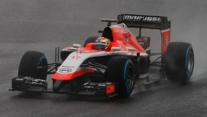 Marussia driver Jules Bianchi of France steers his car during the Japanese Formula One Grand Prix at the Suzuka Circuit in Suzuka, central Japan, Sunday, Oct. 5, 2014. Bianchi has been taken to hospital and is unconscious following a crash during the Japanese Grand Prix. (AP Photo/Shuji Kajiyama)