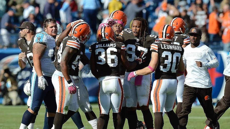 Cleveland Browns players celebrate after beating the Tennessee Titans 29-28 in an NFL football game Sunday, Oct. 5, 2014, in Nashville, Tenn. (AP Photo/Mark Zaleski)