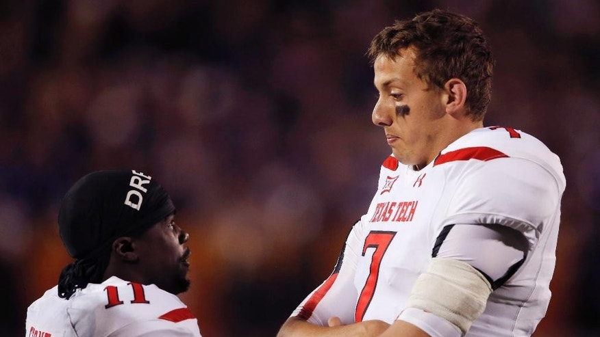 Texas Tech quarterback Davis Webb (7) talks with wide receiver Jakeem Grant (11) during a play review in the second half of an NCAA college football game against Kansas State in Manhattan, Kan., Saturday, Oct. 4, 2014. (AP Photo/Orlin Wagner)
