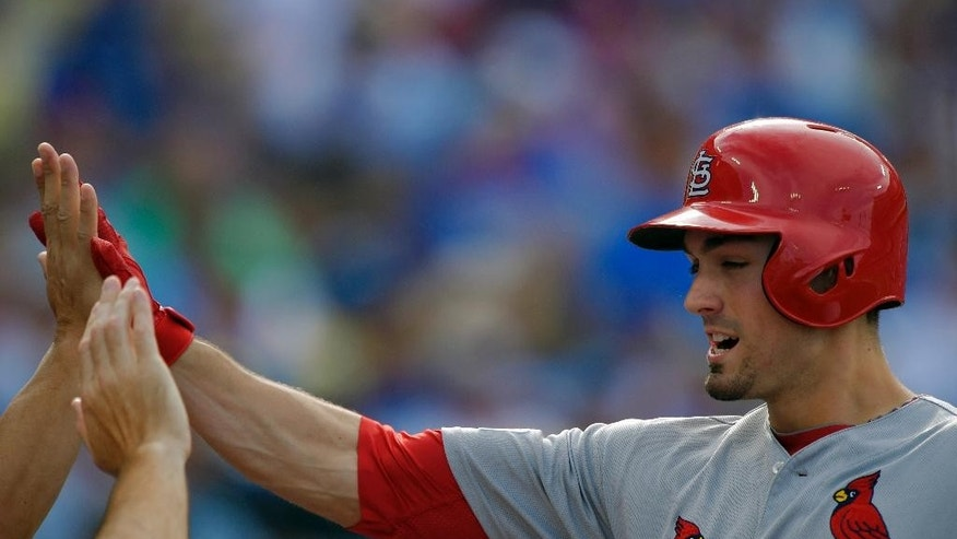 St. Louis Cardinals' Randal Grichuk is greeted after he hit a solo home run against the Los Angeles Dodgers in the first inning of Game 1 of baseball's NL Division Series in Los Angeles, Friday, Oct. 3, 2014. (AP Photo/Mark J. Terrill)