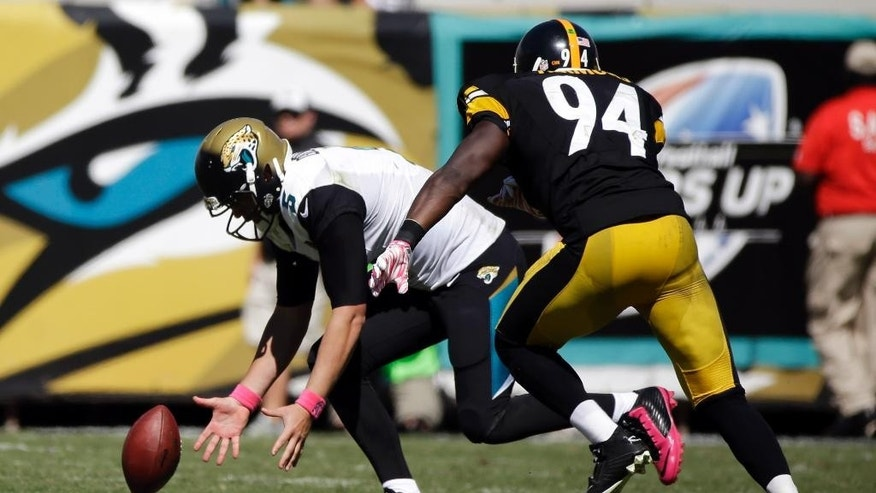 Jacksonville Jaguars quarterback Blake Bortles (5) scrambles to picks up a fumble as he is pressured by Pittsburgh Steelers inside linebacker Lawrence Timmons (94) during the second half of an NFL football game in Jacksonville, Fla., Sunday, Oct. 5, 2014. (AP Photo/Stephen B. Morton)