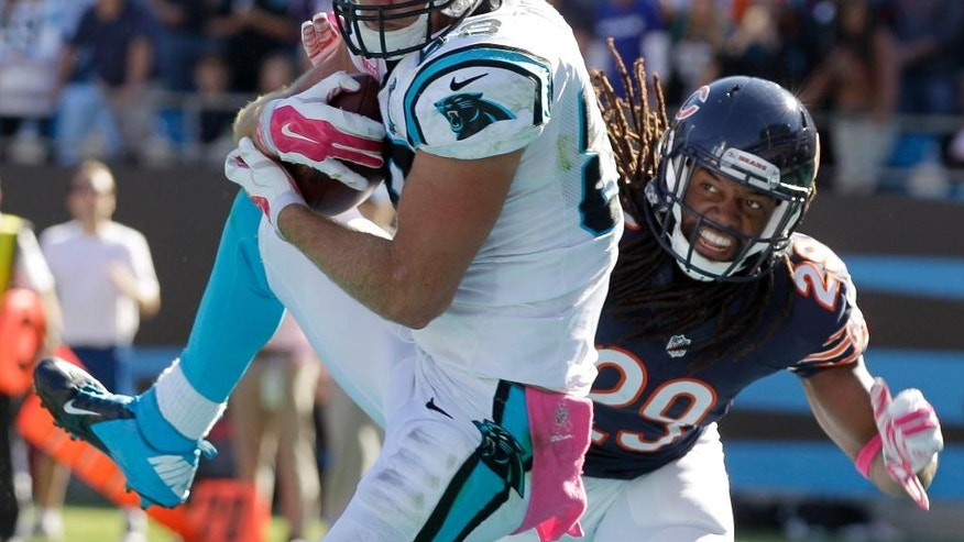 Carolina Panthers' Greg Olsen, front, catches a touchdown pass as Chicago Bears' Danny McCray, back, defends during the second half of an NFL football game in Charlotte, N.C., Sunday, Oct. 5, 2014. (AP Photo/Chuck Burton)