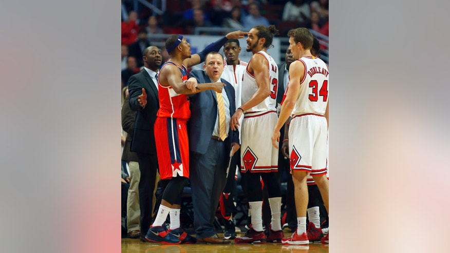 Washington Wizards forward Paul Pierce, left, pokes Chicago Bulls center Joakim Noah (13) in the head during a time-out as Bulls head coach Tom Thibodeau, center, gets between the two during the first half of a pre-season NBA basketball game in Chicago, on Monday Oct. 6, 2014. (AP Photo/Jeff Haynes)