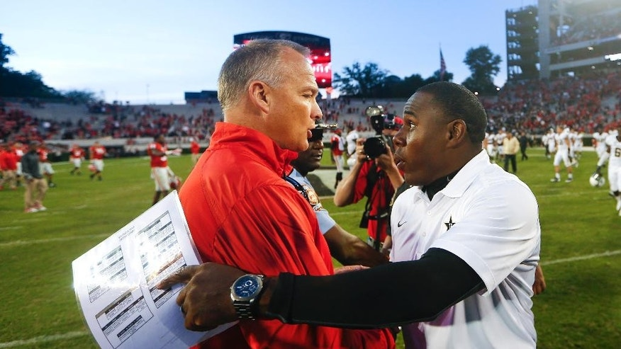 Georgia head coach Mark Richt, left, and Vanderbilt head coach Derek Mason talk after an NCAA college football game Saturday, Oct. 4, 2014, in Athens, Ga.. Georgia won 44-17. (AP Photo/John Bazemore)
