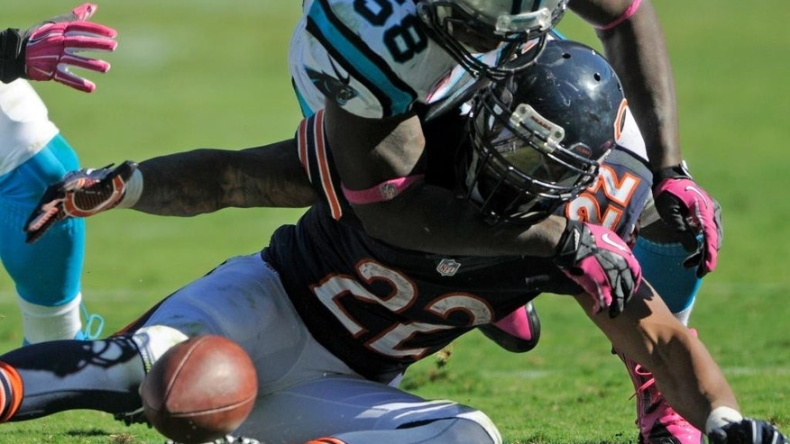 Chicago Bears' Matt Forte (22) fumbles the ball after being hit by Carolina Panthers' Thomas Davis (58) during the second half of an NFL football game in Charlotte, N.C., Sunday, Oct. 5, 2014. The Panthers recovered the fumble. (AP Photo/Mike McCarn)