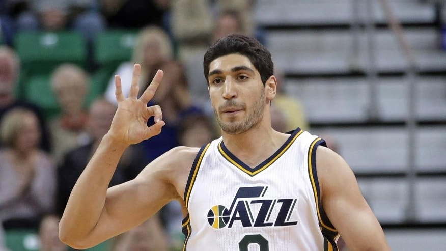 Utah Jazz's Enes Kanter (0) celebrates a 3-pointer in the first quarter during an NBA preseason basketball game against the Portland Trail Blazers Tuesday, Oct. 7, 2014, in Salt Lake City. (AP Photo/Rick Bowmer)