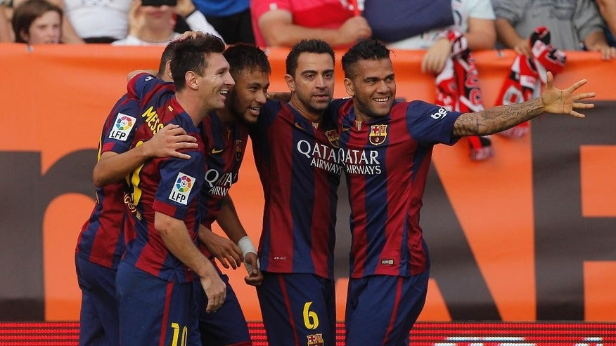 Barcelona's Neymar, second left, celebrates his goal with teammates during a Spanish La Liga soccer match between Rayo Vallecano and FC Barcelona at the Vallecas stadium in Madrid, Spain, Saturday, Oct. 4, 2014. (AP Photo/Andres Kudacki)