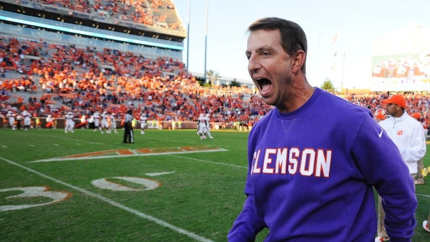 Clemson head coach Dabo Swinney reacts after defeating North Carolina State 41-0 in an NCAA college football game, Saturday, Oct. 4, 2014, in Clemson, S.C. (AP Photo/Rainier Ehrhardt)