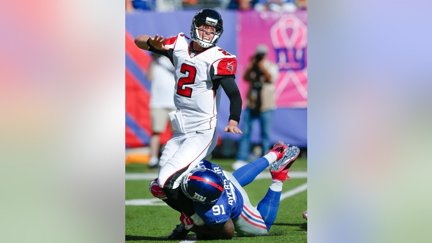 New York Giants defensive end Robert Ayers (91) applies pressure to Atlanta Falcons quarterback Matt Ryan (2) during the second half of an NFL football game, Sunday, Oct. 5, 2014, in East Rutherford, N.J. (AP Photo/Kathy Willens)