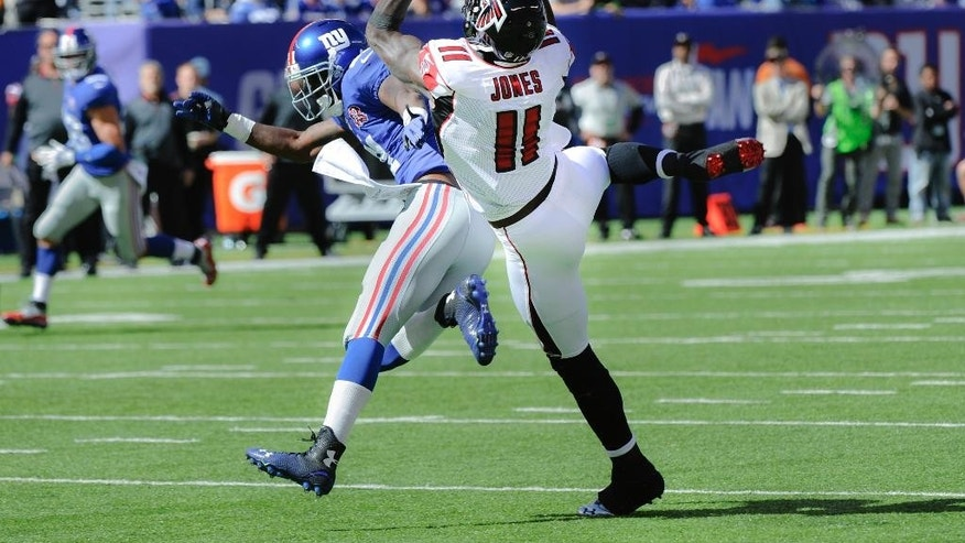 Atlanta Falcons wide receiver Julio Jones (11) is unable to make a catch as New York Giants cornerback Dominique Rodgers-Cromartie (21) defends on the play during the first half of an NFL football game, Sunday, Oct. 5, 2014, in East Rutherford, N.J. (AP Photo/Bill Kostroun)