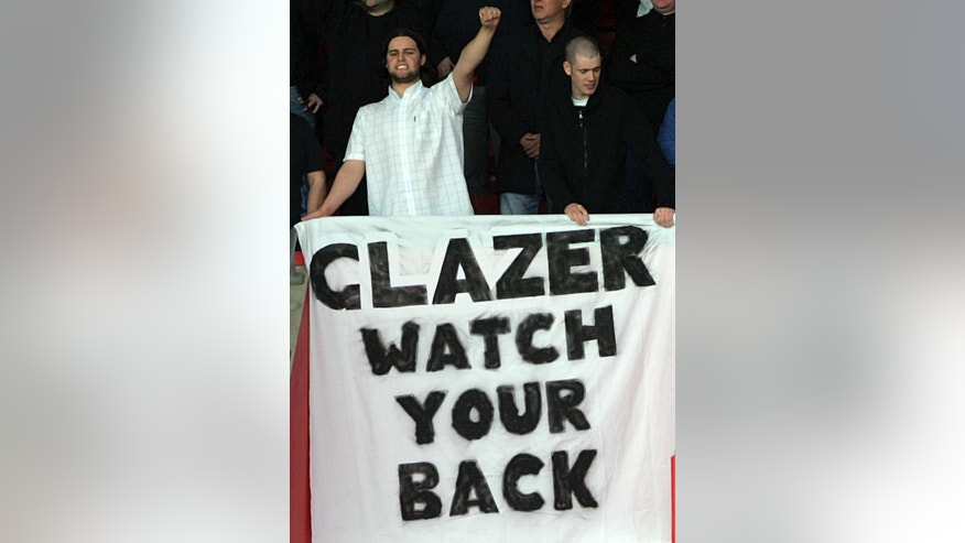 FILE - This is a  Sunday May 15 2005  file photo of Manchester United fans show their displeasure at American Malcolm Glazer's takeover of the club,  during their English Premiership soccer match against Southampton played at St Mary's Stadium, Southampton, England. The FBI investigated threats of violence made against Malcolm Glazer and his family around the time the late owner of the Tampa Bay Buccaneers was acquiring English soccer club Manchester United, according to newly released documents. (AP Photo/Paul Ellis, File)