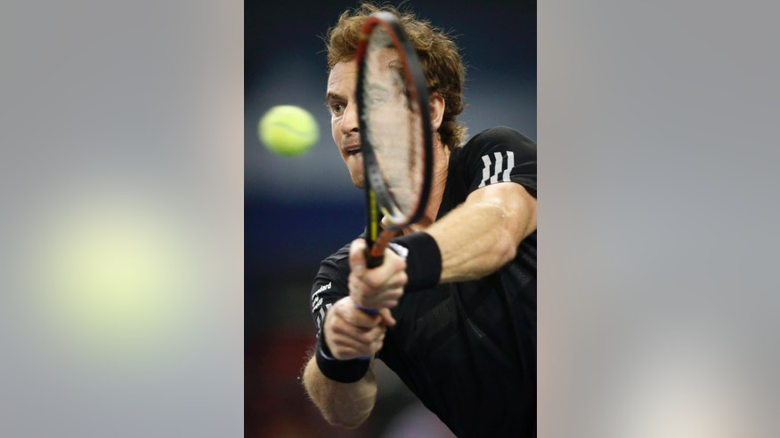 Andy Murray of Britain returns a shot to Teymuraz Gabashvili of Russia during the Shanghai Masters tennis tournament in Shanghai, China, Tuesday, Oct. 7, 2014.  (AP Photo/Vincent Thian)
