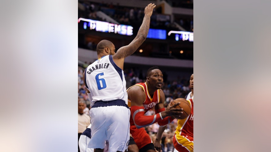 Dallas Mavericks' Tyson Chandler (6) defends as Houston Rockets center Dwight Howard (12) looks for an opening to the basket in the first half of a preseason NBA basketball game, Tuesday, Oct. 7, 2014, in Dallas. (AP Photo/Tony Gutierrez)