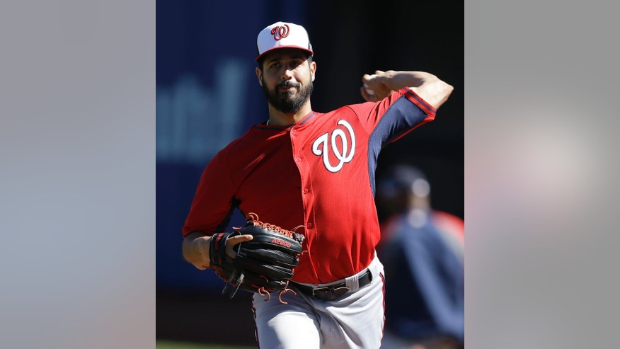 Washington Nationals' Gio Gonzalez warms up during batting practice Sunday, Oct. 5, 2014, in San Francisco. The San Francisco Giants are scheduled to face the Washington Nationals in Game 3 of the NL Division Series on Monday. (AP Photo/Ben Margot)