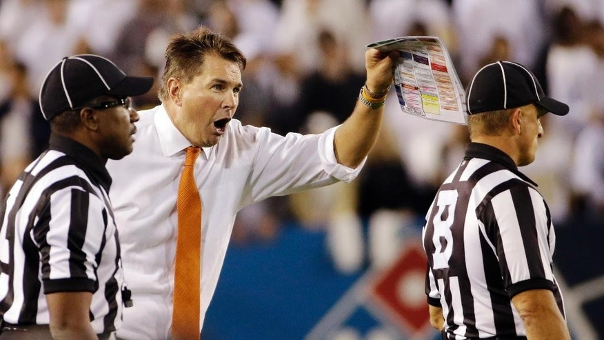 Miami head coach Al Golden, second from left, shouts at an official during the first half of an NCAA college football game against Georgia Tech, Saturday, Oct. 4, 2014, in Atlanta. (AP Photo/David Goldman)