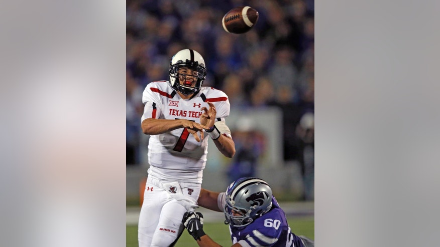 Texas Tech quarterback Davis Webb (7) throws under pressure from Kansas State defensive tackle Will Geary (60) during the second half of an NCAA college football game in Manhattan, Kan., Saturday, Oct. 4, 2014. Kansas State defeated Texas Tech 45-13. (AP Photo/Orlin Wagner)
