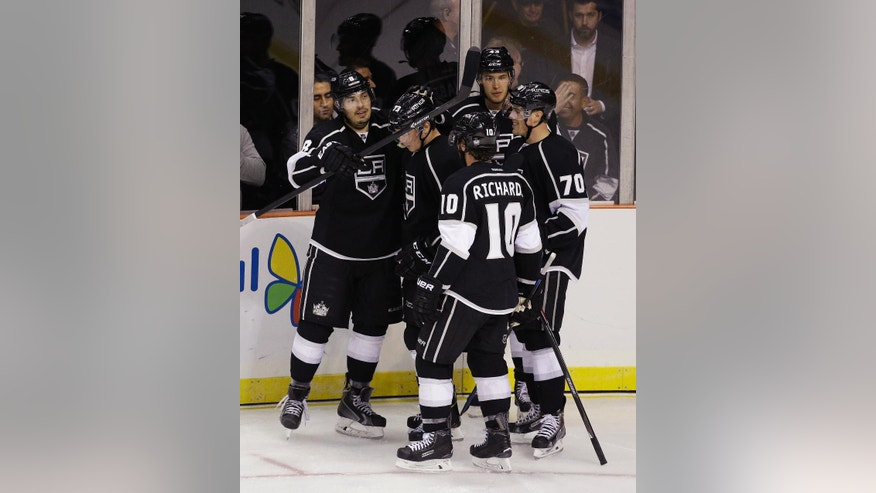 Los Angeles Kings celebrate after center Tyler Toffoli, second from left, scored during the second period of an NHL preseason hockey game against the Colorado Avalanche on Saturday, Oct. 4, 2014, in Las Vegas. (AP Photo/John Locher)