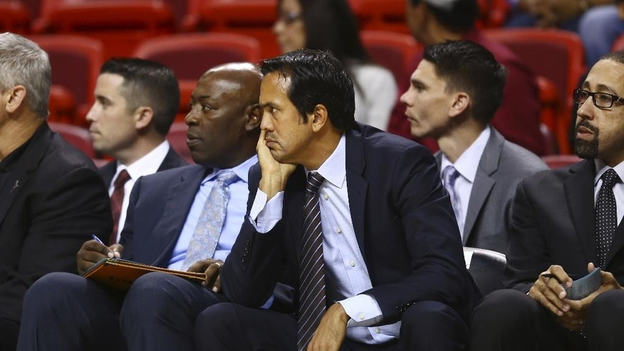 Miami Heat coach Erik Spoelstra watches game action against the Orlando Magic during the first half of  a NBA basketball game in Miami, Oct. 7, 2014. (AP Photo/J Pat Carter)