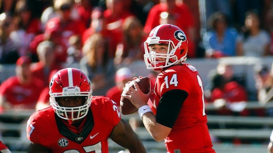 Georgia quarterback Hutson Mason (14) looks for a receiver as Georgia running back Nick Chubb (27) runs a pass route in the first half of an NCAA college football game against Vanderbilt  Saturday, Oct. 4, 2014, in Athens, Ga. Georgia won 44-17.  (AP Photo/John Bazemore)