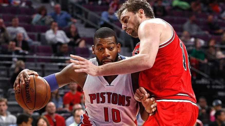 Detroit Pistons forward Greg Monroe (10) drives on Chicago Bulls' Pau Gasol in the first half of a preseason NBA basketball game in Auburn Hills, Mich., Tuesday, Oct. 7, 2014. (AP Photo/Paul Sancya)