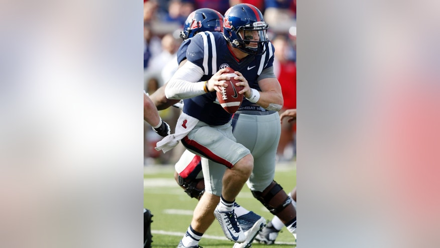Mississippi quarterback Bo Wallace runs upfield against Alabama during the first half of an NCAA college football game in Oxford, Miss., Saturday, Oct. 4, 2014. Mississippi won 23-17. (AP Photo/Rogelio V. Solis)