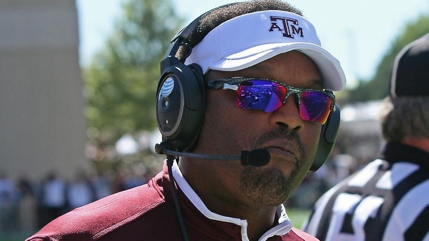 Texas A&M  coach Kevin Sumlin watches from the sidelines during the second half of an NCAA college football game against Mississippi State in Starkville, Miss., Saturday, Oct. 4, 2014. (AP Photo/Jim Lytle)