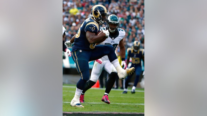 St. Louis Rams' Benny Cunningham, left, rushes for a touchdown past Philadelphia Eagles' Nate Allen during the second half of an NFL football game, Sunday, Oct. 5, 2014, in Philadelphia. (AP Photo/Matt Rourke)
