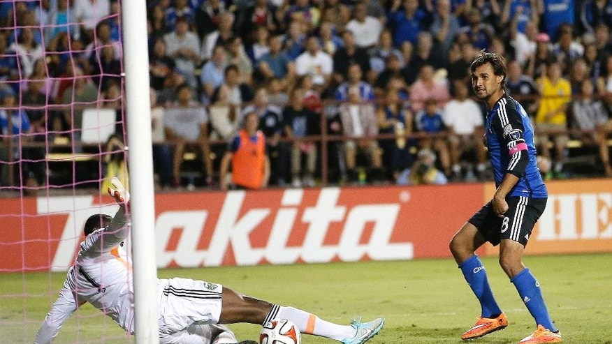 San Jose Earthquakes forward Chris Wondolowski, right, scores a goal past Portland Timbers goalkeeper Donovan Ricketts during the second half of an MLS soccer game in Santa Clara, Calif., Saturday, Oct. 4, 2014. (AP Photo/Tony Avelar)