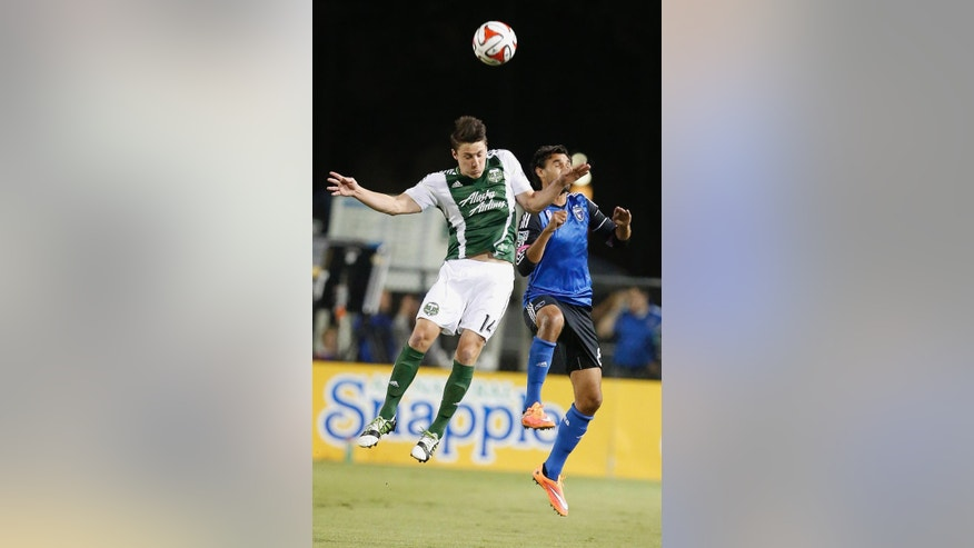 Portland Timbers midfielder Ben Zemanski, left, goes for a header against San Jose Earthquakes forward Chris Wondolowski, right, during the first half of an MLS soccer game in Santa Clara, Calif., Saturday, Oct. 4, 2014. (AP Photo/Tony Avelar)
