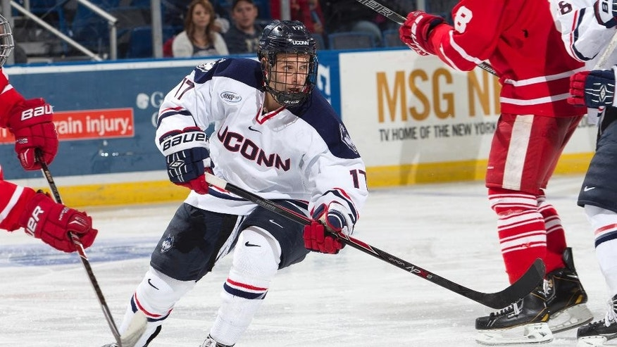In this Dec. 29, 2013 photo released by the University of Connecticut, men's hockey team captain Ryan Tyson (17) skates against Sacred Heart in Hartford, Conn. The Huskies open the 2014-15 season in Division 1-AA, the newest member of Hockey East. (AP Photo/University of Connecticut, Stephen Slade)