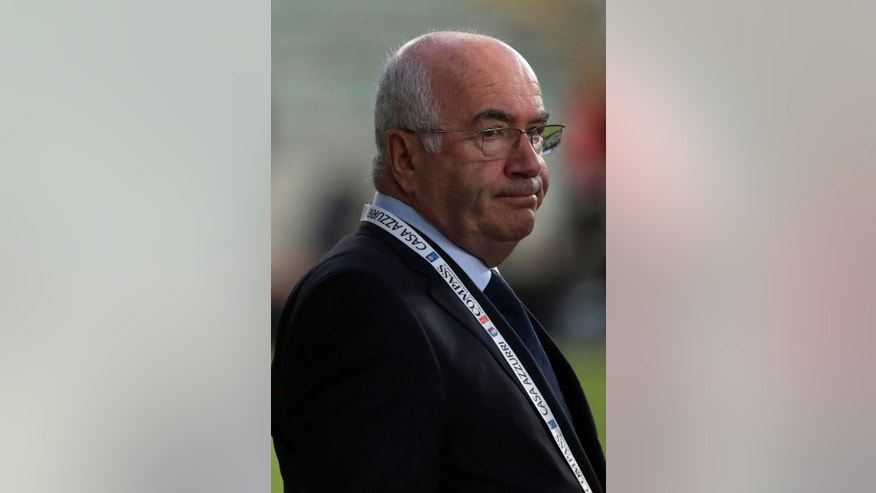 In this photo taken on Thursday, Sept. 4, 2014, Paolo Tavecchio waits for the start of a friendly soccer match between Italy and The Netherlands in Bari, Italy. UEFA has banned Italian soccer federation president Carlo Tavecchio for six months following a racist comment during his electoral campaign. Tavecchio, a long-standing executive in Italian football, was elected president in August despite causing a stir over a reference to bananas when discussing the presence of foreign players in Italy. (AP Photo/Gregorio Borgia)