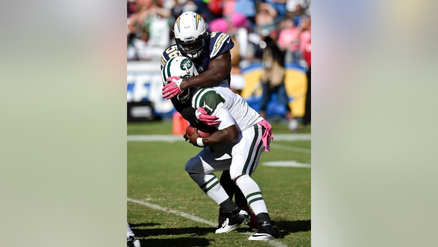 New York Jets quarterback Michael Vick (1) is sacked by San Diego Chargers inside linebacker Donald Butler during the second half of an NFL football game, Sunday, Oct. 5, 2014, in San Diego. (AP Photo/Denis Poroy)
