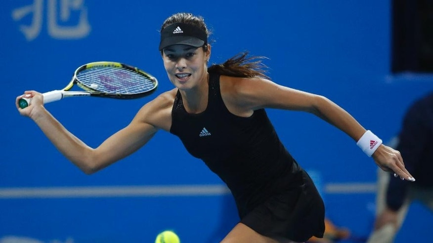 Ana Ivanovic of Serbia returns a shot against Maria Sharapova of Russia during the semi final match of the China Open tennis tournament at the National Tennis Stadium in Beijing, China, Saturday, Oct. 4, 2014. (AP Photo/Vincent Thian)