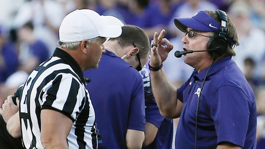 TCU head coach Gary Patterson argues with referee Mike Defee during the second half of an NCAA college football game against Oklahoma at Amon G. Carter Stadium, Saturday, Oct. 4, 2014, in Fort Worth, Texas. TCU won 37-33. (AP Photo/Brandon Wade)